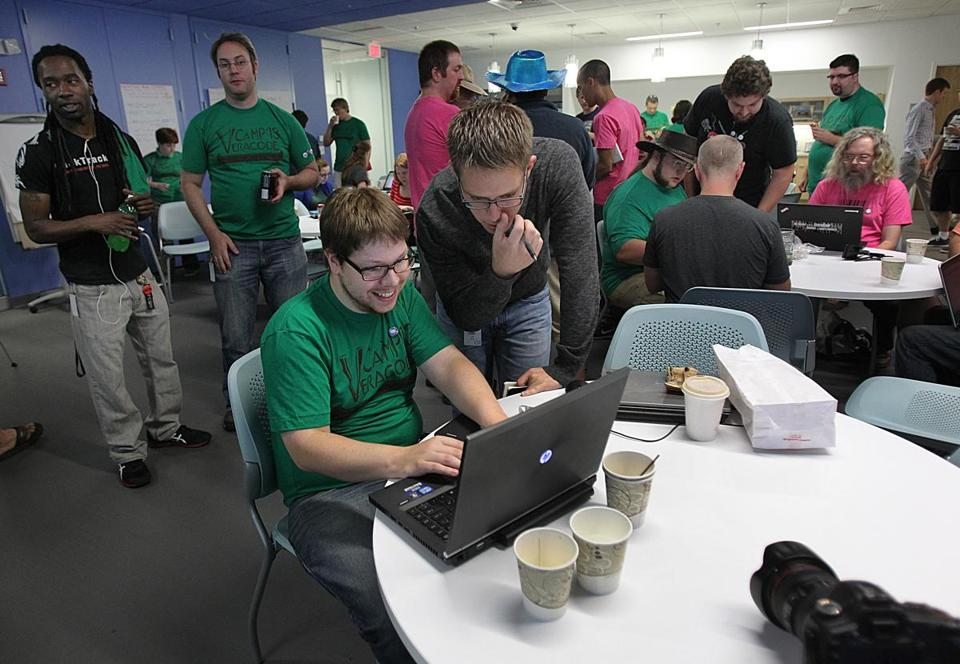Matt Margelony and Tyler White get ready for a Hackathon kickoff event meeting.  (Suzanne Kreiter Photo/Globe staff)