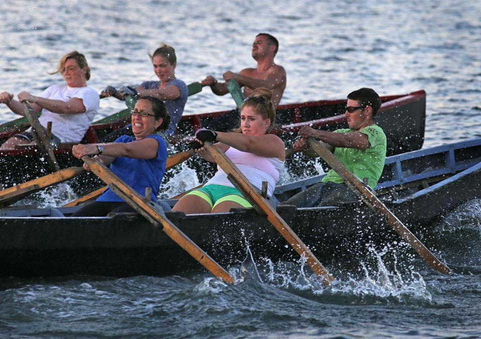 Members of the Boston Irish Currach Rowing Club train together in the waters off the Quincy Yacht Club at Houghs Neck.