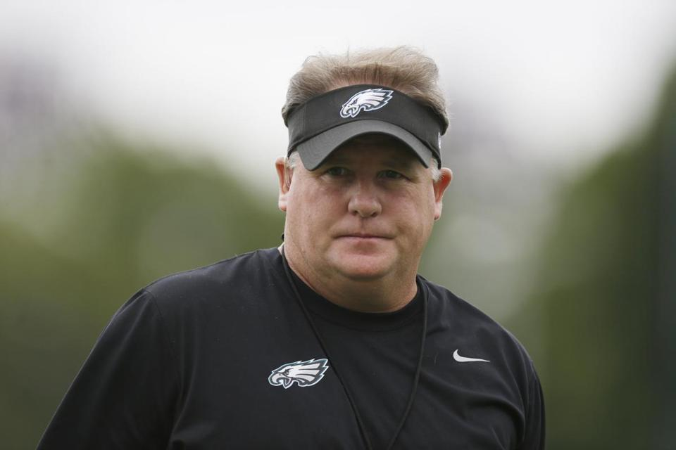 New Eagles coach Chip Kelly walked on the field during Thursday's joint workout with the Patriots.