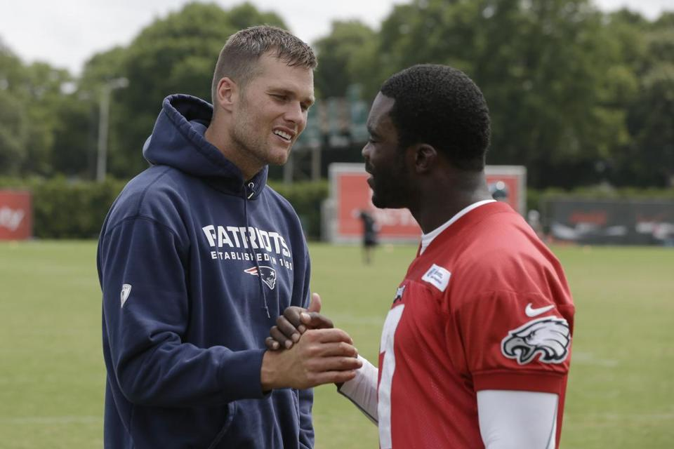 Tom Brady, left, spent some time with Eagles QB Michael Vick during Thursday's workout.