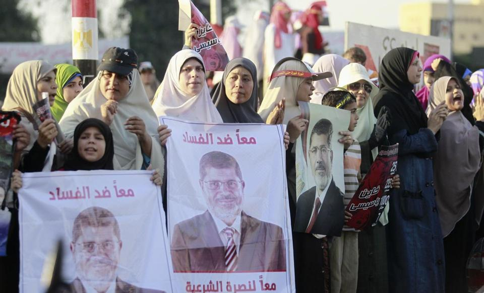 Supporters of Mohammed Morsi, Egypt's ousted president, shouted slogans Sunday in Giza.