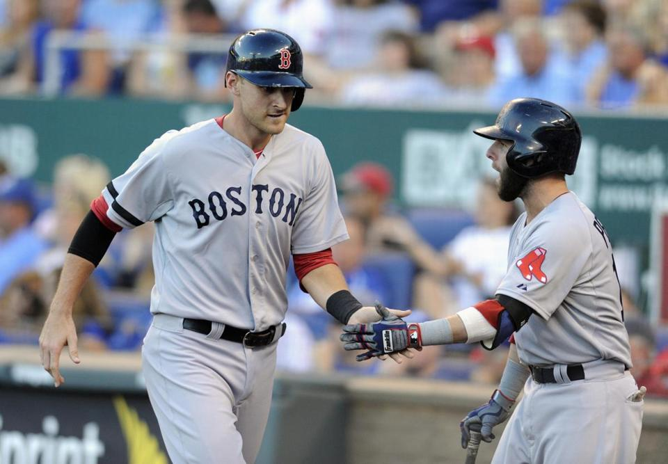 Will Middlebrooks (left) was congratulated by Dustin Pedroia after scoring on a fourth-inning double by Jacoby Ellsbury.