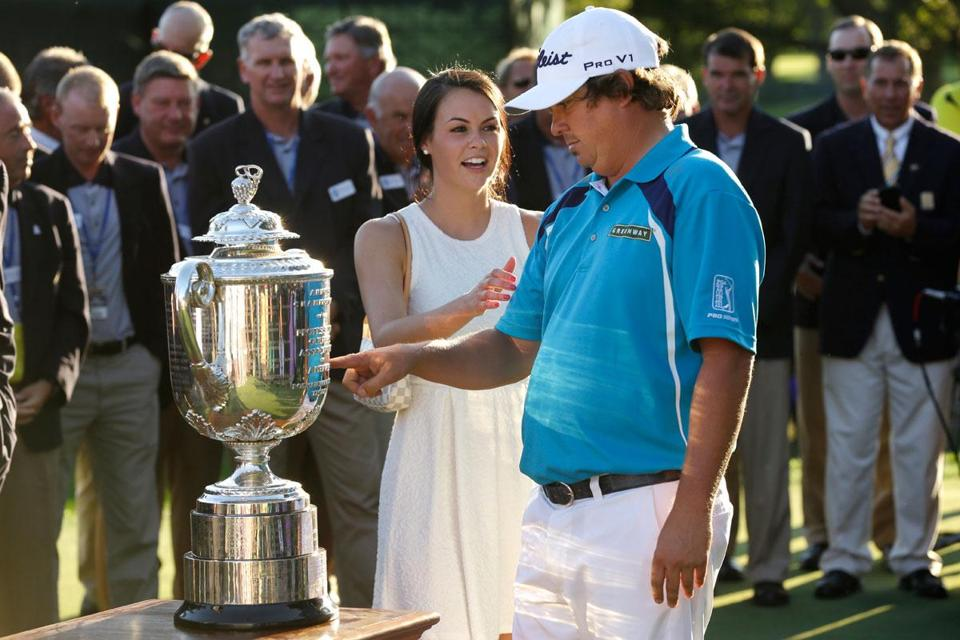 Jason Dufner admires the latest addition to his trophy case — The Wanamaker Trophy — as he celebrates his PGA win with wife Amanda.