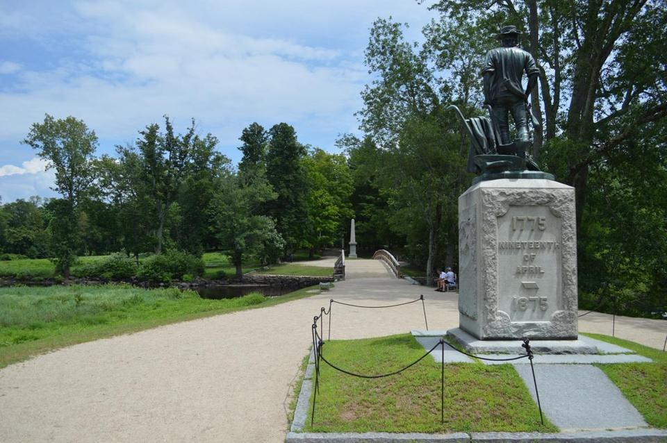 The Minuteman Statue and the Obelisk Monument are located on the grounds near the Old North Bridge.