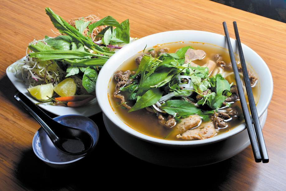 At Pho Le in Dorchester, you can try noodle soup with shredded vegetables on the side.