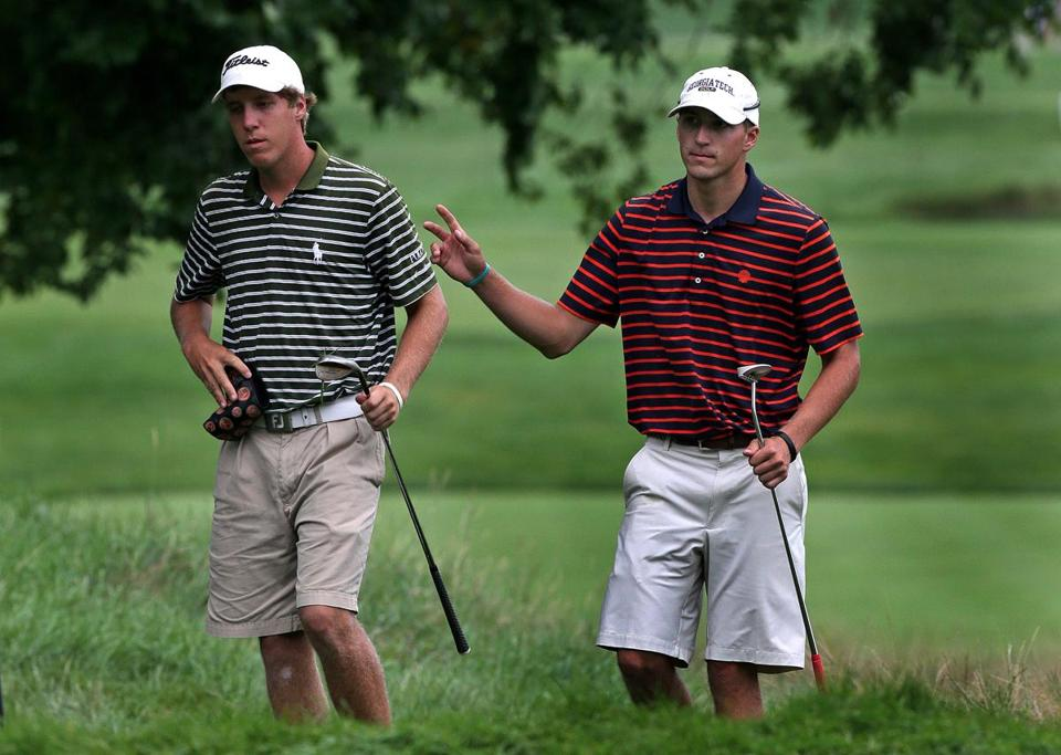 Richy Werenski of South Hadley, with his caddie, brother Mickey, acknowledges cheers after a nice bunker shot on 18.
