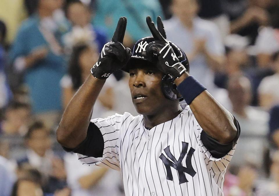 Alfonso Soriano celebrates his two-run home run in the fifth. He added a three-run shot, ending with six RBIs.