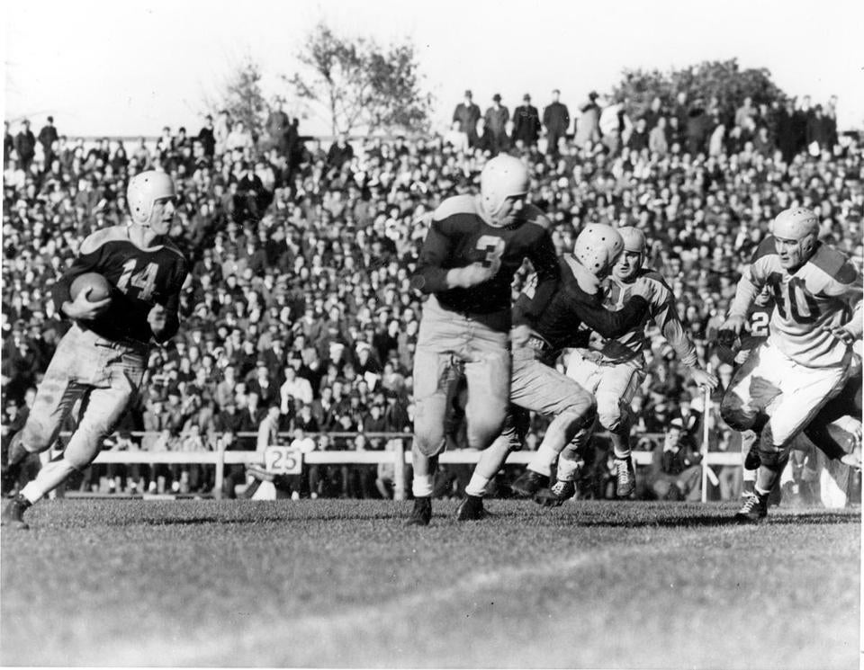 Don Hutson, left with ball, led the NFL in touchdown receptions nine times and in catches seven times.