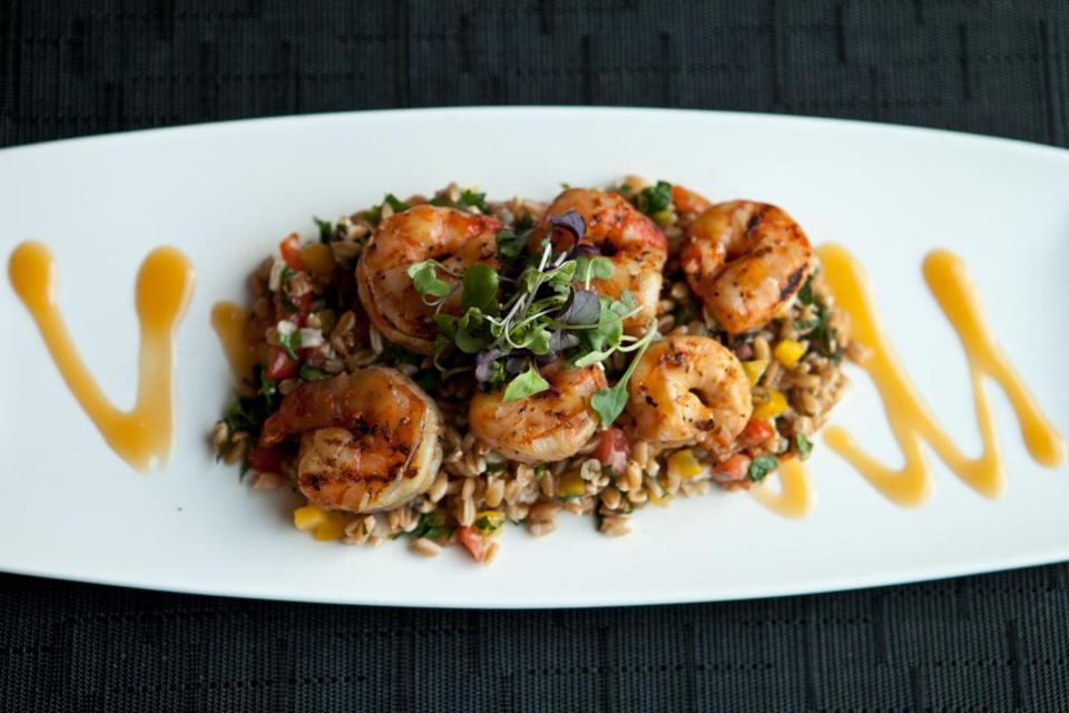 Spicy grilled mojito shrimp skewers are served at Fenmore American Bistro.