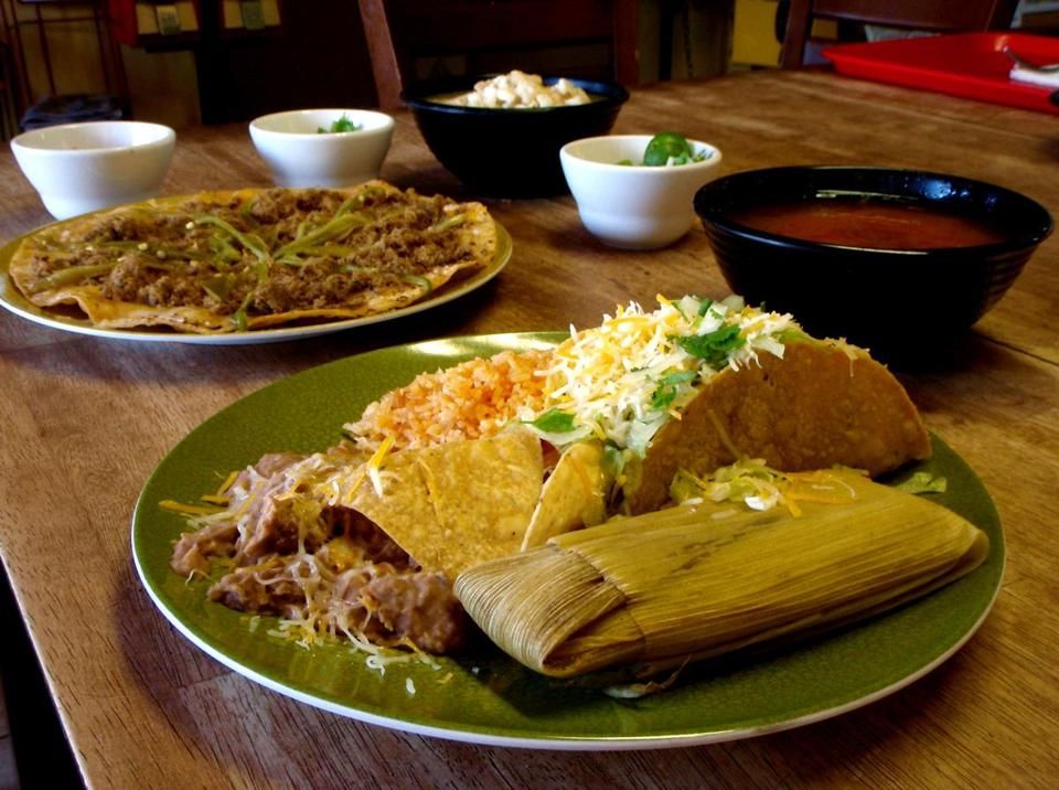 Tamale and taco combo plate with cheese crisp, menudo, and red pozole.