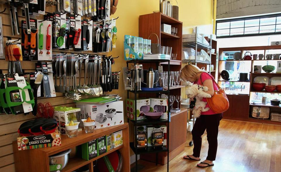 In her Roslindale  Village shop, Maryann Halley (below) sells cookware, cookbooks, and more.