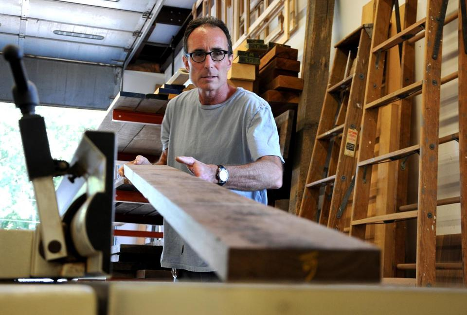 """We are creating heirlooms,"" Daryl Evans said of his work at Masterpiece Woodworks in Avon."