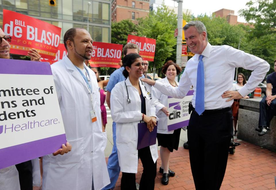 A poll has Bill de Blasio (right) ahead among Democrats in a race for New York City mayor.