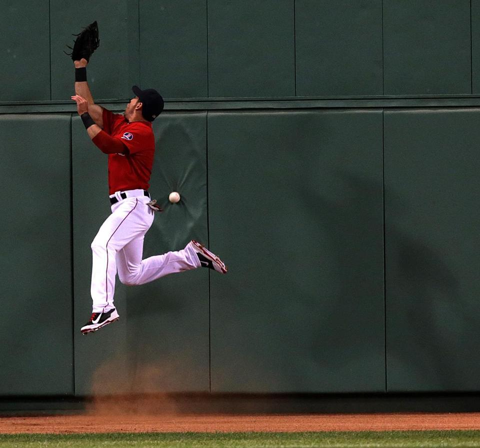 Center fielder Jacoby Ellsbury misplays a high fly ball off the wall hit by Yankees' Eduardo Nunez in the fourth, one of several defensive lapses.