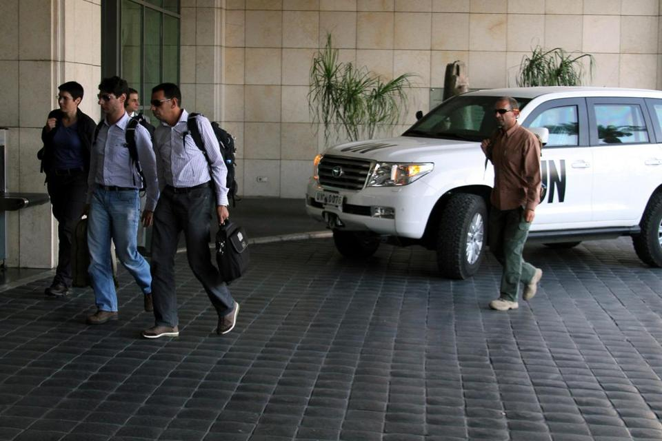 A team of UN chemical weapons inspectors arrived at their hotel in Damascus Sunday. Both sides in Syria's 29-month civil war vow to cooperate with the UN team.