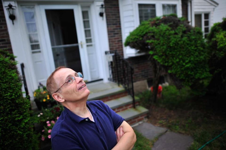 Paul Yovino watched from his front lawn as a jet began its descent into Logan Airport. Residents say the noise is near-constant some days.
