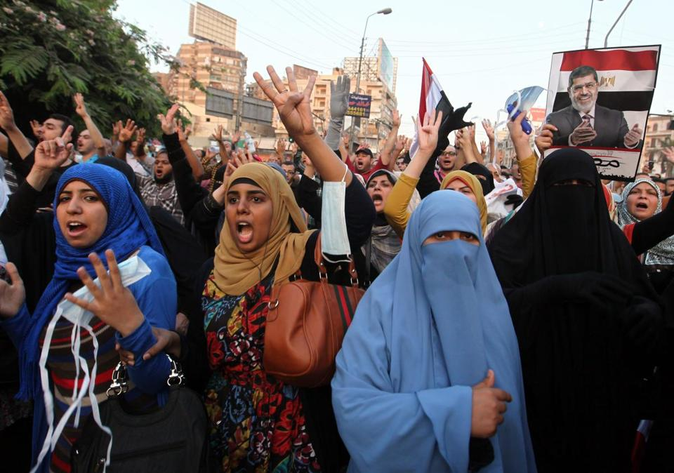 Backers of ousted president Mohammed Morsi marched in Cairo, defying a warning that the army will confront violence. Sunday's rallies were more subdued than in recent days.