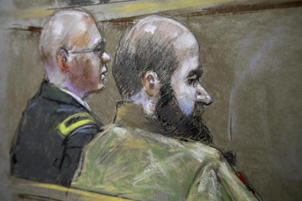 A sketch depicted Major Nidal Hasan (right) and a lawyer in court for the slayings at Fort Hood in Texas in 2009.