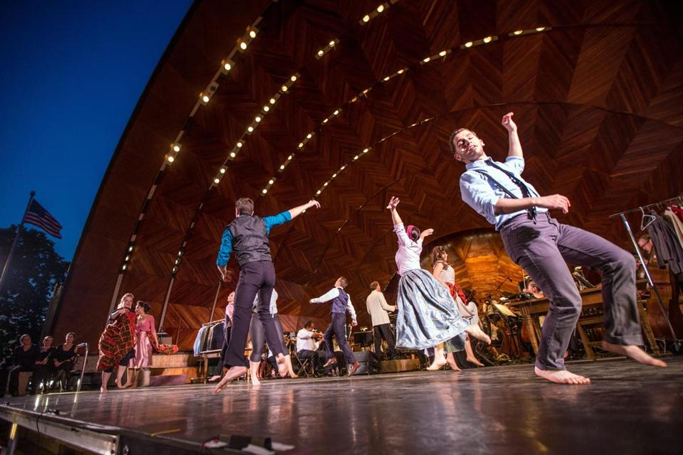 "Jake Novak (right) and other cast members of ""Kiss Me, Kate"" performing a musical number on the Hatch Shell stage Wednesday."