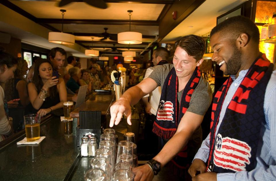 Revolution players Bobby Shuttleworth (second from right) and Andrew Farrell got behind the bar at Clerys on Thursday night.
