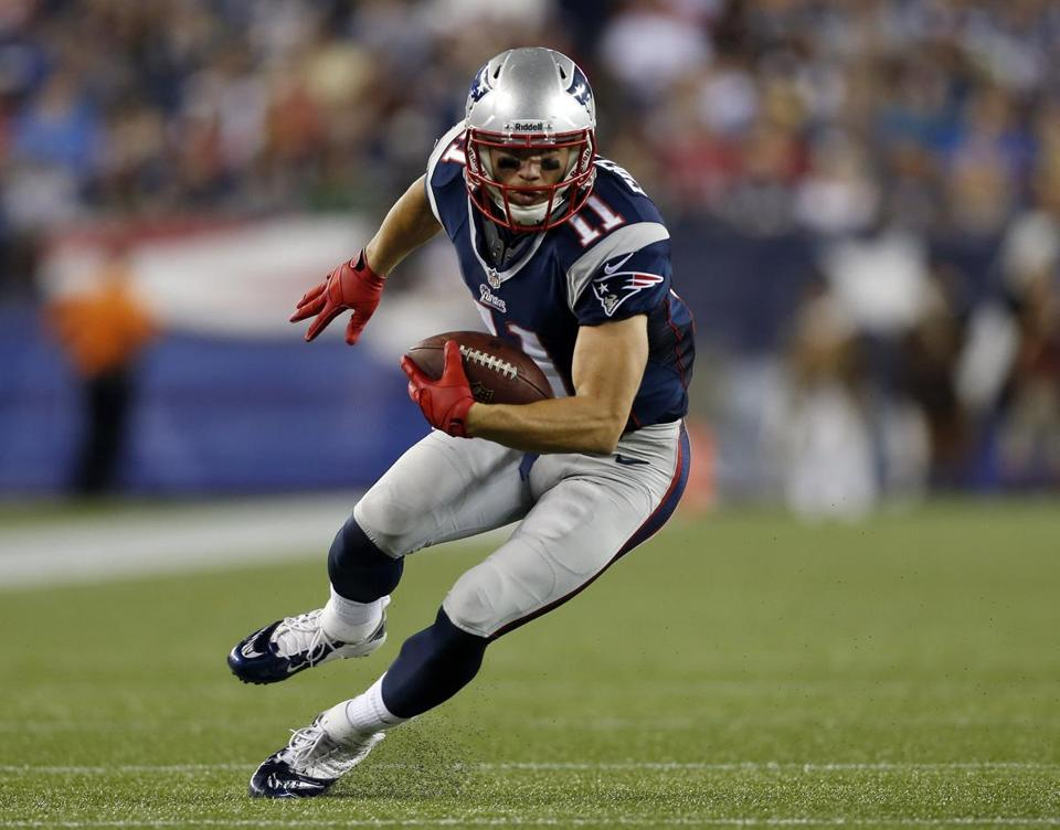 New England Patriots wide receiver Julian Edelman looks to run after a catch against the Tampa Bay Buccaneers in the second quarter of an NFL preseason football game Friday, Aug. 16, 2013, in Foxborough, Mass. (AP Photo/Michael Dwyer)