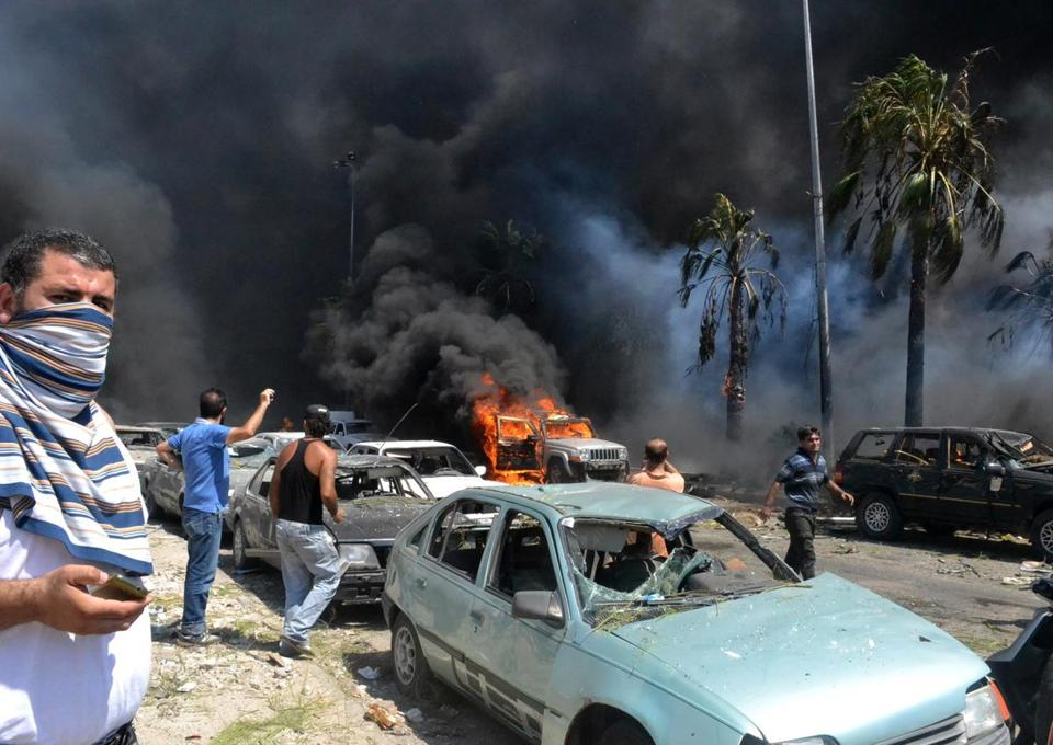A car bomb exploded outside a packed mosque in Tripoli on Friday — part of a series of coordinated attacks that killed 29 people and wounded hundreds of others.