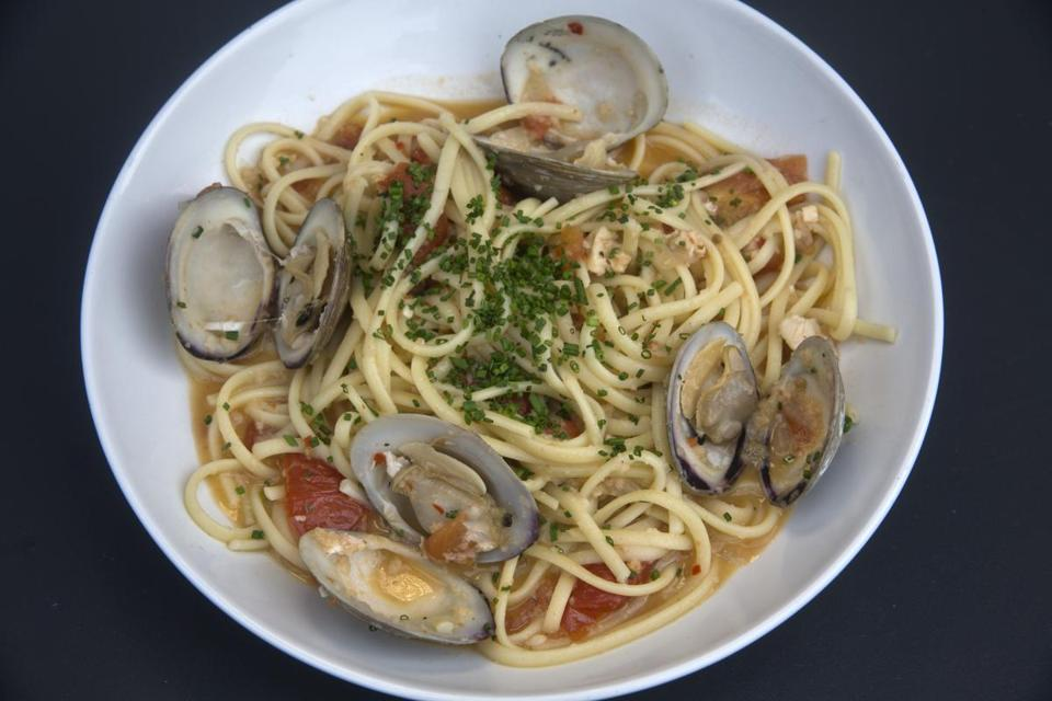 Above: linguine, served al dente, with clams and bits of tomato. Right: the outdoor patio at Sterling's.