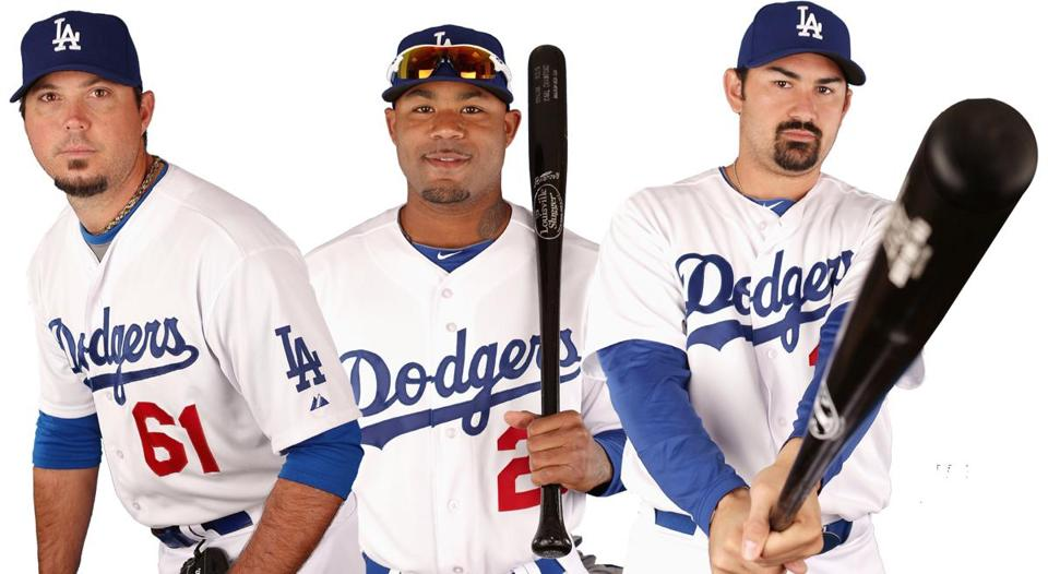 Josh Beckett (left), Carl Crawford (center), and Adrian Gonzalez went from Boston to Los Angeles in last year's blockbuster nine-player transaction.