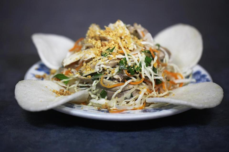 New Dong Khanh's shredded chicken salad, made with rice vermicelli, lettuce, carrots, cucumbers, bean sprouts, mint, and basil.