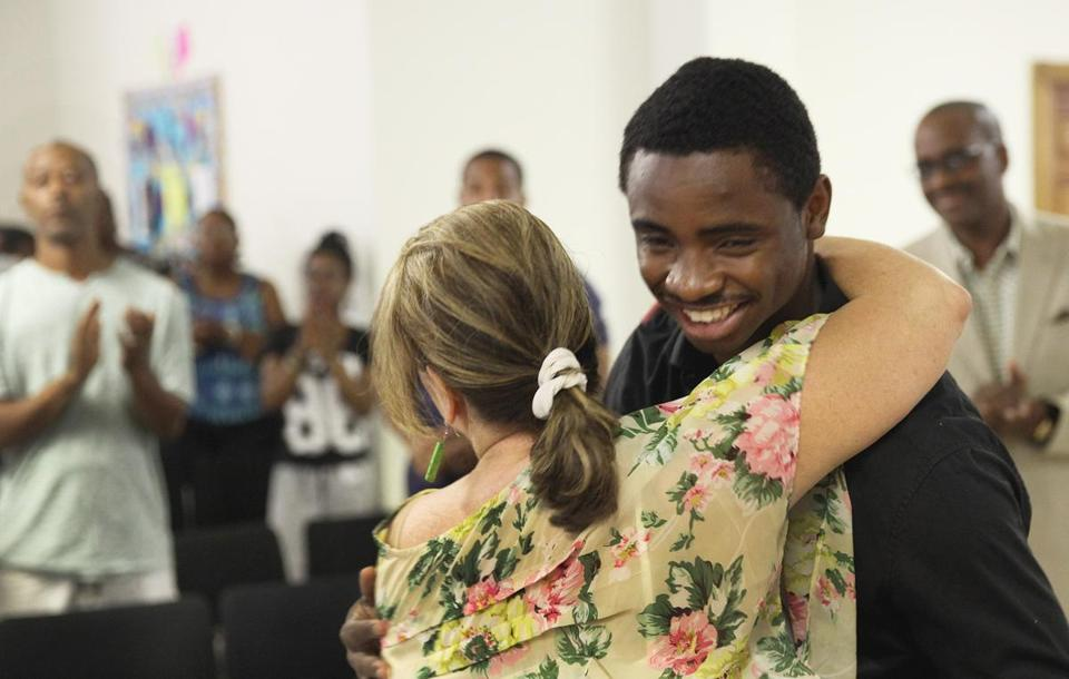 Jean Isme, 19, hugged Lynn Currier, organizer of the mock retrial of George Zimmerman, after the event at Greater Love Tabernacle Church in Dorchester on Saturday.