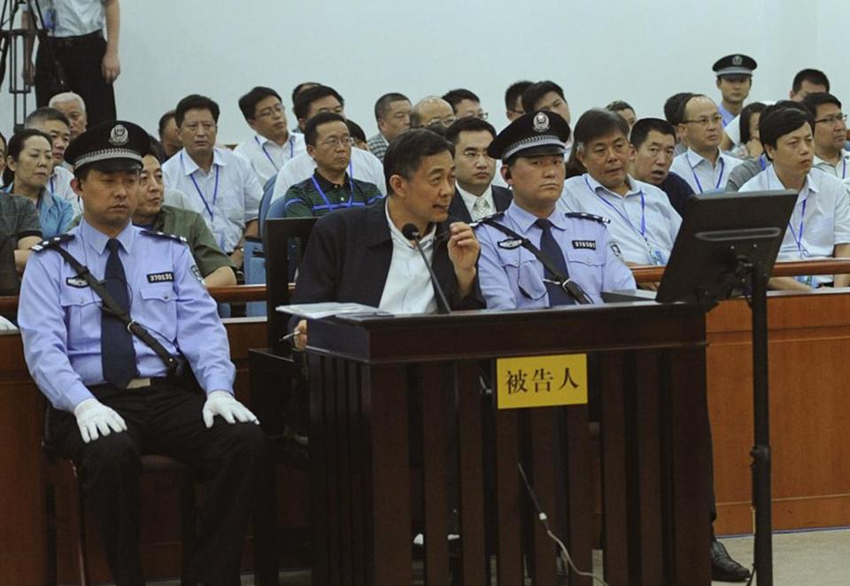 Former Communist leader Bo Xilai (center)  of Chongqing, China, was in court Saturday at his abuse of power trial, where the disgraced politician acknowledged making mistakes.