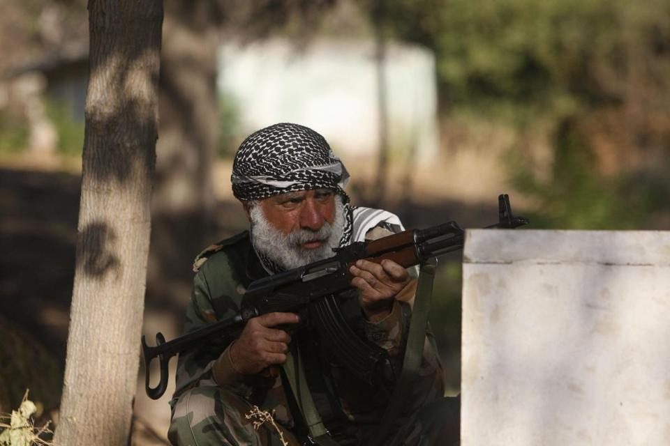 A member of the Free Syrian Army took a position at a public park in Aleppo.
