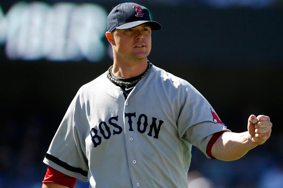 Red Sox starter Jon Lester likes what he sees after Juan Uribe lined into an inning-ending double play in the seventh.
