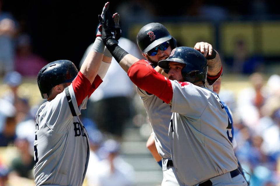 Jonny Gomes (right) plated Dustin Pedroia (left) and Mike Napoli (rear) on his three-run homer in the first inning.