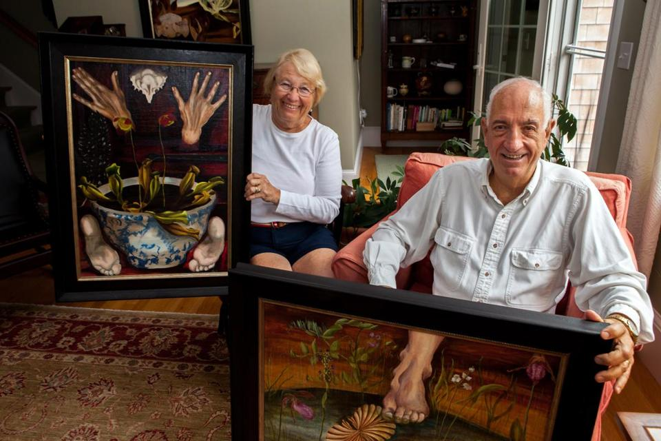Sydney Lewis Glover and her husband, J. Denis, with a few of her mother's Surrealist  paintings. Glover found them after Doris Lindo Lewis died in 1995.