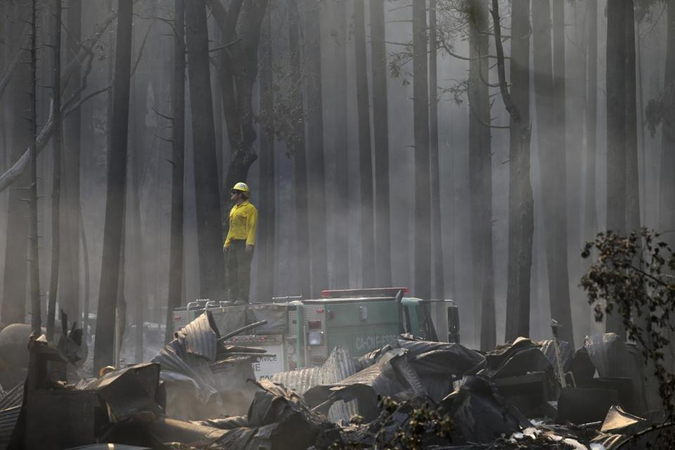 A firefighter on Monday surveyed a campground that was destroyed by the Rim Fire near Yosemite National Park.