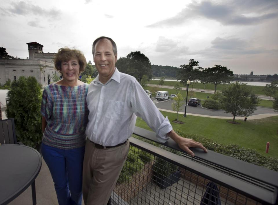 Faye and Charlie Ruopp on the balcony of their Brighton condo, which they bought after selling their Newton house.