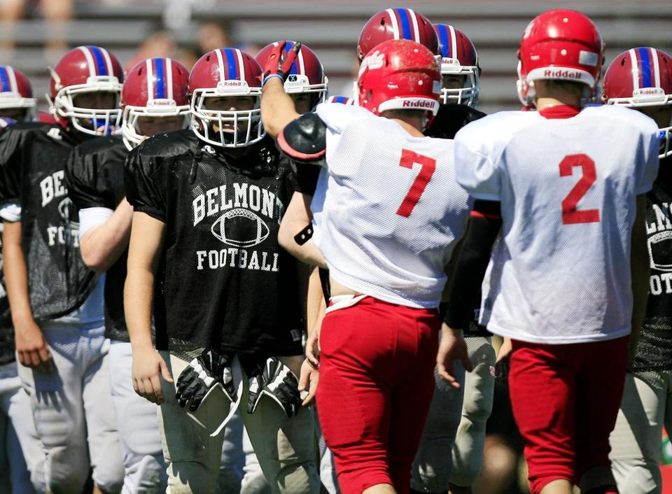 Players from both side shake hands at the end of the Waltham at Belmont scrimmage.