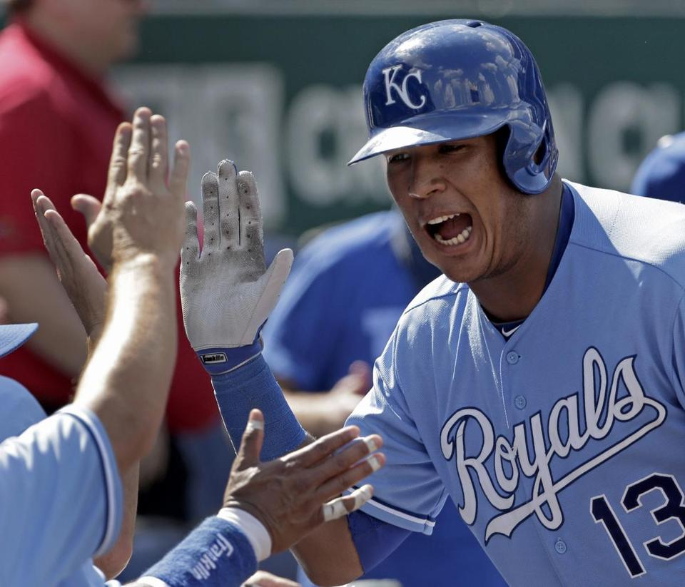Salvador Perez celebrates after his three-run homer in the sixth inning buried Tampa Bay in Kansas City's rout.