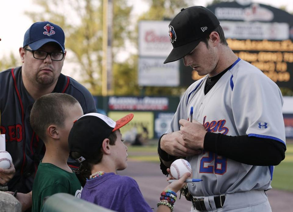 Aberdeen Ironbird's Michael Yastrzemski signs autographs before their game against the Lowell Spinners.