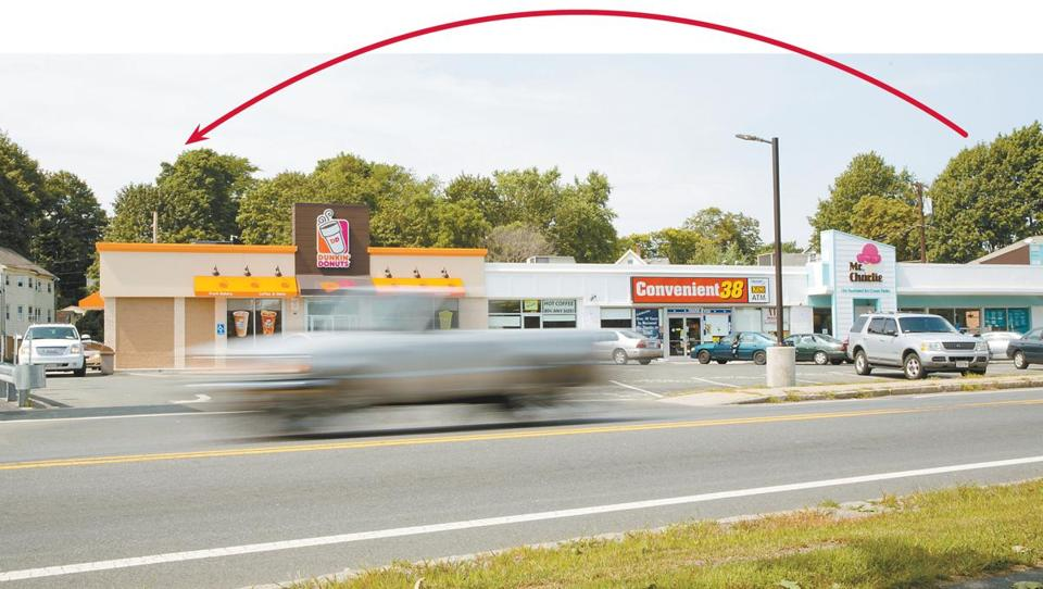This Woburn Dunkin' Donuts moved to the other end of its complex, installed a drive-through, and watched sales jump.