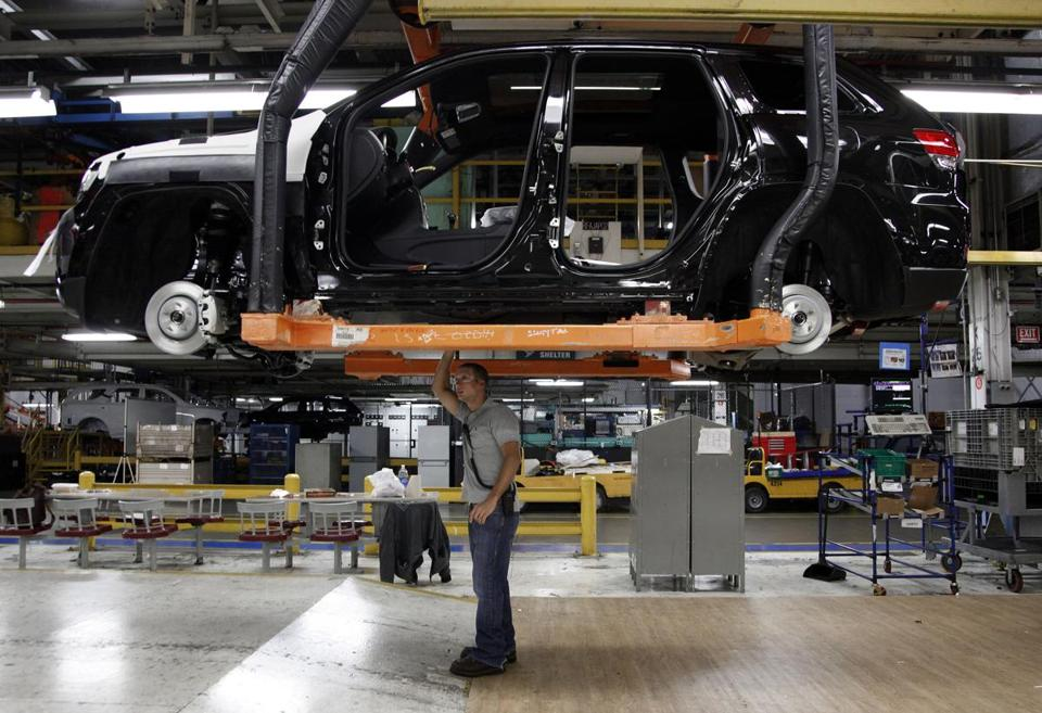 A worker at a Chrysler plant in Detroit inspected a chassis.