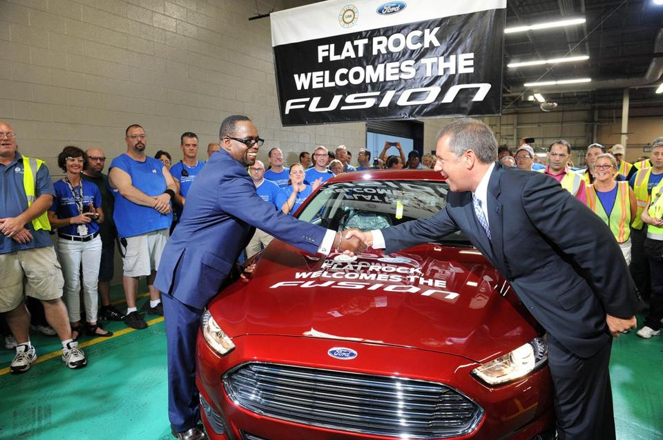 Union leader Jimmy Settles (left) greeted Ford executive Joe Hinrichs at the Flatrock, Mich., auto plant.