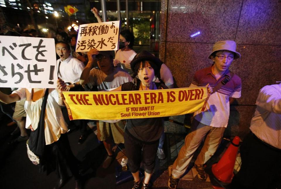 Protesters at the headquarters of Tokyo Electric Power Co.  demanded a halt to Japan's nuclear development plans.