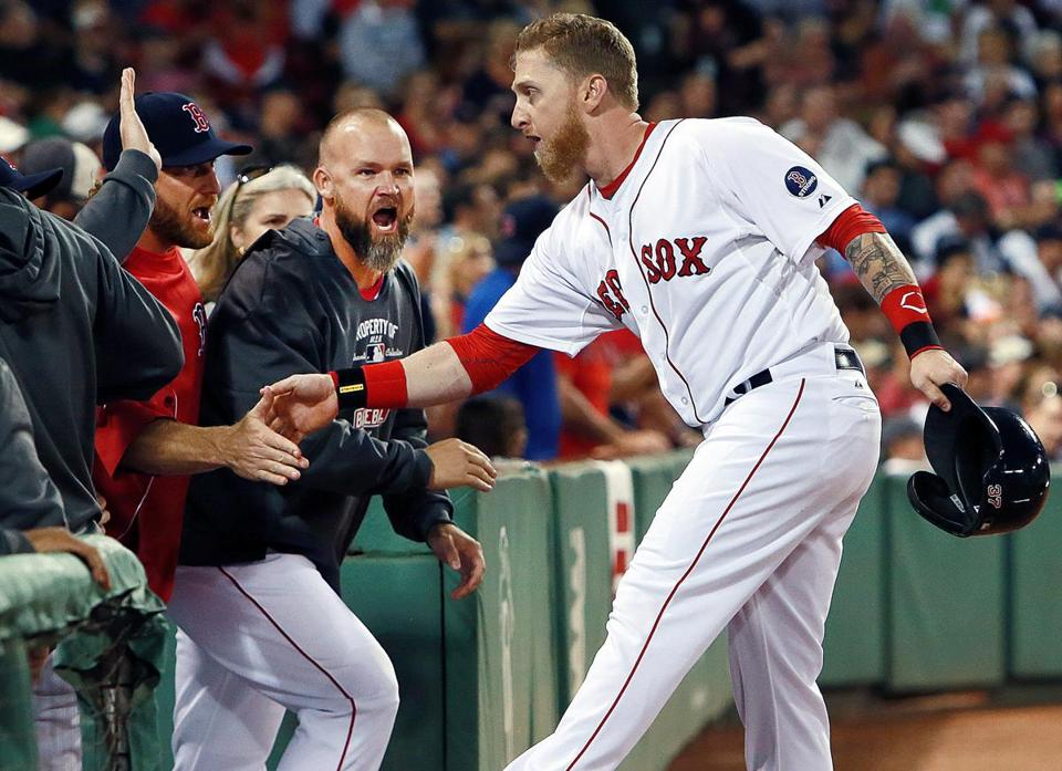 Red Sox teammates congratulated Mike Carp after his game-winning hit in the eighth inning.