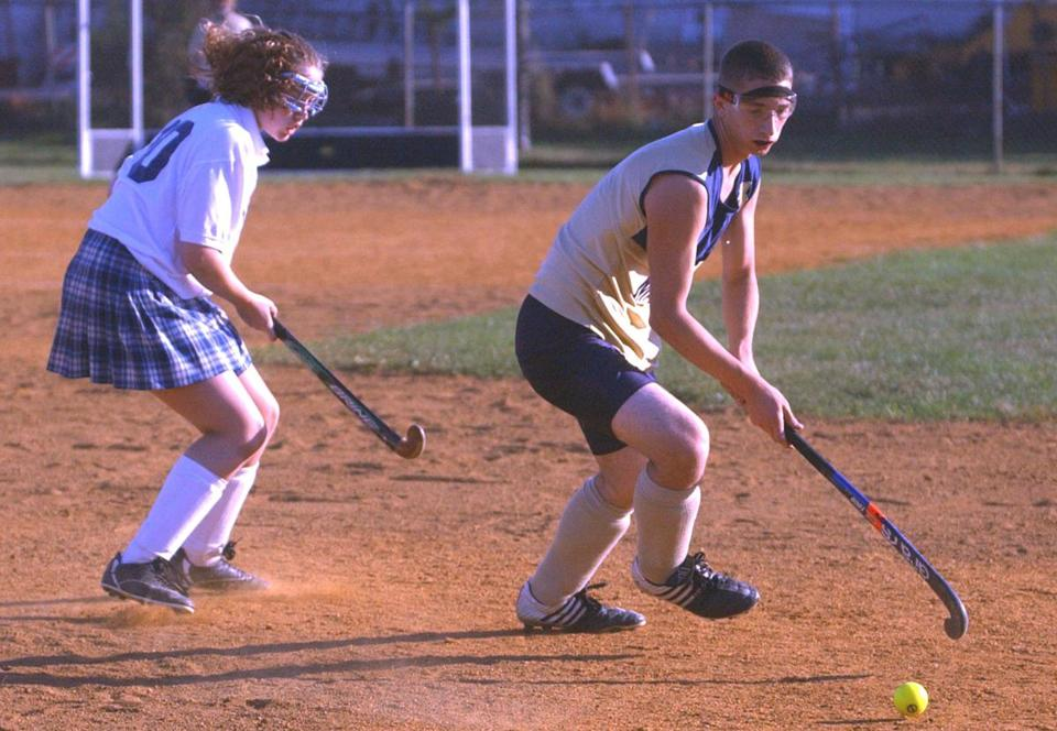Mike Conway-Semensi was the only boy on Malden High School's field hockey team in 2003.