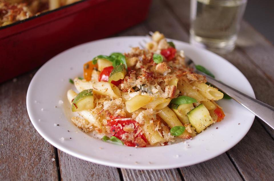 Baked pasta with zucchini, tomatoes, and capers.