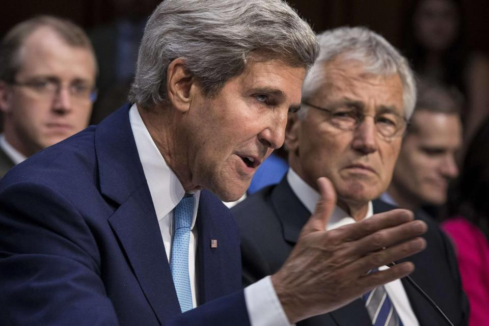 Secretary of Defense Chuck Hagel (right) listened as Secretary of State John Kerry spoke during a hearing of the Senate Foreign Relations Committee.