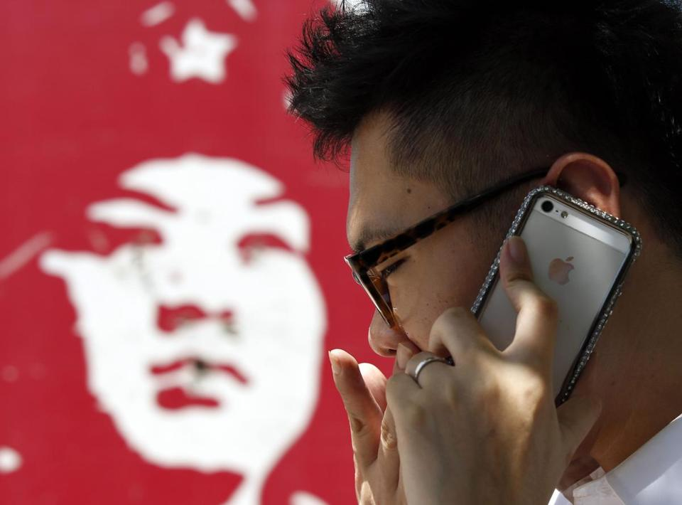 Speculation about iPhone sales potential in China may be lifting Apple stock.
