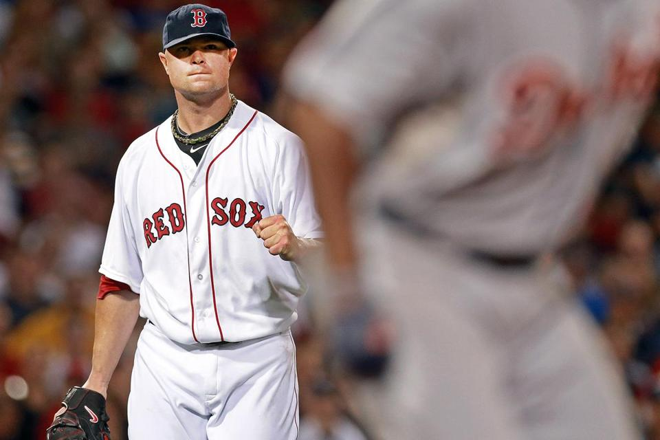 Jon Lester, who struck out nine, was at his fist-pumping best after Torii Hunter grounded out to end the seventh.
